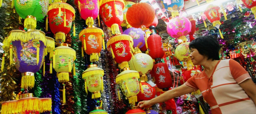GUANGZHOU, CHINA - SEPTEMBER 13: (CHINA OUT) A customer buys lanterns at a store to prepare for the upcoming Mid-Autumn Festival on September 13, 2005 in Guangzhou, Guangdong Province, China. The Mid-Autumn Festival is for family reunion and will fall on September 18,  the 15th day of the eighth lunar month. (Photo by China Photos/Getty Images)